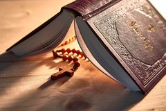 A detailed book with psalms and wooden beads royalty free stock image