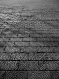 Detailed Brick Walkway With Shadow. A closeup of a brick walkway showing the detail of the design on the bricks stock image