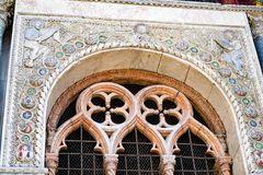 Detailed carvings on the exterior of St. Mark`s Basilica in Venice. Beautiful stone carvings around an exterior window of St. Mark`s Basilica in Venice, Italy Royalty Free Stock Photos