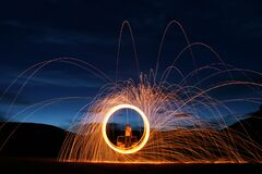 Free Detailed Casting Fire Flare Steel Wool Night Long Exposure On Front Of Hood In Field With Stars Above Stock Photos - 176752323