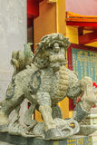 Detailed Chinese design with Gods statues in gold including wall Royalty Free Stock Photos