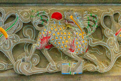 Detailed Chinese design with Gods statues in gold including wall Royalty Free Stock Photography