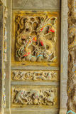 Detailed Chinese design with Gods statues in gold including wall Royalty Free Stock Photo