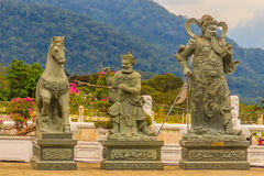 Detailed Chinese design with Gods statues in gold including wall Stock Photo