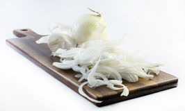 Detailed chopped white onions on a white background - composition Stock Image