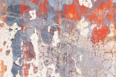 Detailed close up view on colorful peeling paint on aged and weathered concrete walls stock photo