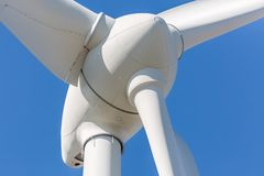 Detailed close up view of a wind turbine. Generator, rotor and blade view, white, background, environment, electricity, mill, technology, environmental stock photography
