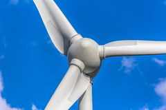 Detailed close up view of a wind turbines; generator, rotor and blade view. On blue sky background, environment, electricity, mill, technology, environmental royalty free stock photos