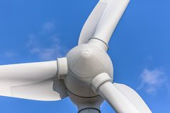 Detailed close up view of a wind turbines; generator, rotor and blade view. On blue sky background, environment, electricity, mill, technology, environmental stock photo