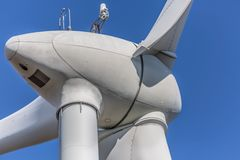Detailed close up view of a wind turbines; generator, rotor and blade view. On blue sky background, environment, electricity, mill, technology, environmental royalty free stock images