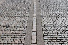 Detailed close views on cobblestone streets and sidewalks in different perspectives royalty free stock images