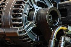 Detailed closeup of alternator generator machine engine Royalty Free Stock Image