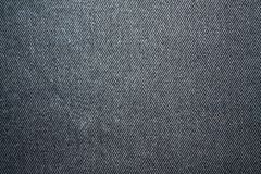 Detailed closeup of blank grungy denim. Vintage dark gray jeans, good for background Royalty Free Stock Images