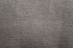 Detailed closeup of blank grungy denim. Vintage gray jeans, good for background Royalty Free Stock Photos