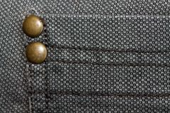 Detailed closeup of blank grungy denim. Vintage gray jeans with rivet, good for background Royalty Free Stock Photography