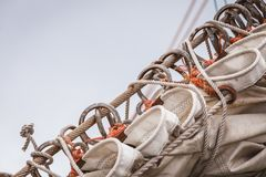 Detailed closeup of mast rigging on sail boat. During cruise. Marine objects concept Stock Photography