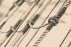 Detailed closeup of mast rigging on sail boat. During cruise. Marine objects concept Royalty Free Stock Photo