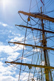 Detailed closeup of mast rigging top on sail boat. During cruise, shot on blue sky. Marine objects concept Stock Photography