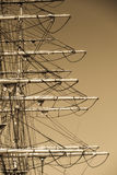 Detailed closeup of mast rigging top on sail boat. During cruise, shot on dark sepia sky. Marine objects concept Stock Photos