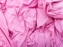 Detailed closeup of pink quilt bedding. Fabric textures and patterns concept. Detailed closeup of pink creased quilt bedding Royalty Free Stock Photography