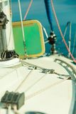 Detailed closeup of rigging on sail boat. During cruise. Marine objects concept Stock Photos