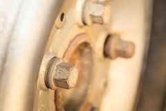 Detailed closeup of rim wheel screw Royalty Free Stock Photo