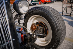 detailed closeup view of old classic vintage car wheel and other brake components Royalty Free Stock Photography