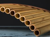 Detailed closeup view of a pan flute. Dark background Stock Photography