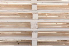 Detailed closeup of wooden pallets. Delivery, fabrication, wooden fabric concept. Detailed closeup, euro pallets made of light wood Stock Photo