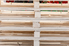 Detailed closeup of wooden pallets. Delivery, fabrication, wooden fabric concept. Detailed closeup, euro pallets made of light wood Royalty Free Stock Photos