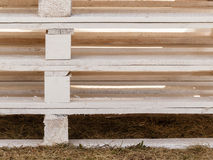 Detailed closeup of wooden pallets. Delivery, fabrication, wooden fabric concept. Detailed closeup, euro pallets made of light wood Royalty Free Stock Photo