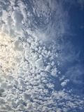 Detailed Cloudscape. With fluffy white clouds in beautiful  blue sky Royalty Free Stock Images