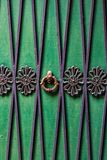 Detailed, Colored Door Photo, Close Up. Texture and pattern. Green door with steel hanger and trims royalty free stock photos