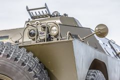 Detailed front view of old armored military vehicle. White background, car, arms, army, power, heavy, all-terrain, wheels, armed, headlights, off-road, object stock image