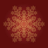 Detailed golden snowflake Stock Images