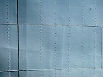 Detailed gray metal historic ship wall with seams and rivets. wi. Detailed gray metal historic World War 2 ship wall with seams and rivets. with a chip of paint Royalty Free Stock Photography