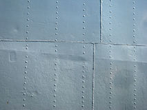 Detailed gray metal historic ship wall with seams and rivets Stock Image