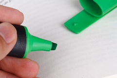 Detailed Green Higlighter Pen. Close up detailed side view of green highlighter pen on paper Stock Photo