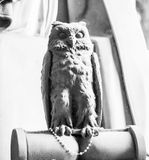 Detailed, grey owl made of stone, positioned in the Staglieno cemetery in Genoa, Italy Stock Photo