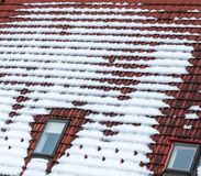 Snow on the roof. Detailed image of snowy roof tiles Royalty Free Stock Photos