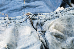 Detailed light blue jeans. Jeans cloth piece Royalty Free Stock Images