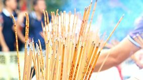 The detailed look at burning sticks in Buddhist monastery stock footage