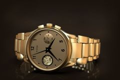 Gold wrist watch with metal bracelet, close-up