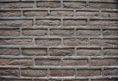 Detailed old brown brick wall background texture stock photo