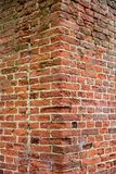 Detailed old red brick wall. Abstract pattern of an old red, orange and black brick corner wall with lots of texture useful for backgrounds and wallpapers Royalty Free Stock Photos