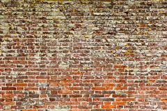 Detailed old red brick wall. Abstract pattern of an old red, orange and black brick  wall with lots of texture useful for backgrounds and wallpapers Stock Photo
