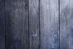 Detailed old structured wooden planks in different shades of gray as background. Old structured wooden planks painted in different shades of gray, detailed Royalty Free Stock Images