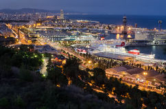 Detailed panoramic view on night illumination of Barcelona port with cruising liners, Spain Royalty Free Stock Image
