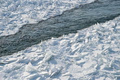 Detailed photo of frozen St-Lawrence River in Montreal, with cru Stock Photography