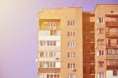 Detailed photo of multi-storey residential building with lots of balconies and windows. Hostels for poor people in Russia and Ukr Royalty Free Stock Image